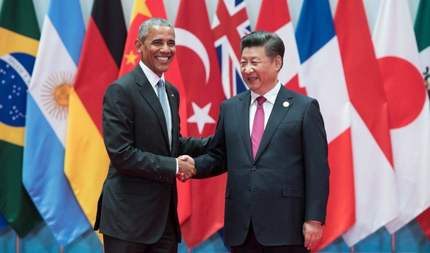 US President Barack Obama being welcomed by Chinese President Xi Jinping at the G20 summit in Hangzhou, China, Sept. 4, 2016.