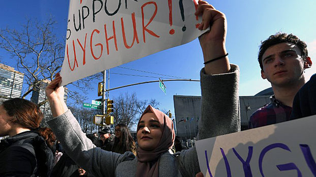 People participate in a rally outside the US Mission to the United Nations in New York to encourage the State Department to fight for the freedom of the majority-Muslim Uyghur population imprisoned in Chinese internment camps, Feb. 5, 2019.