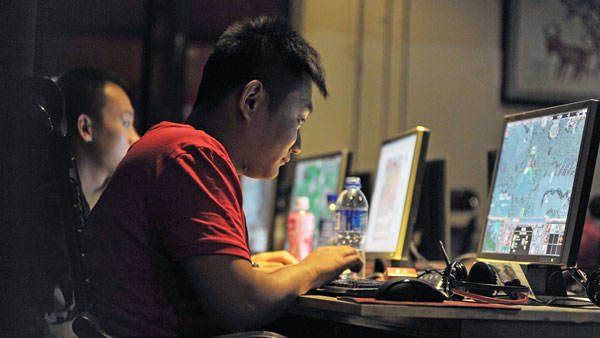 A Chinese man surfs the web at an internet cafe in Beijing in a file photo.