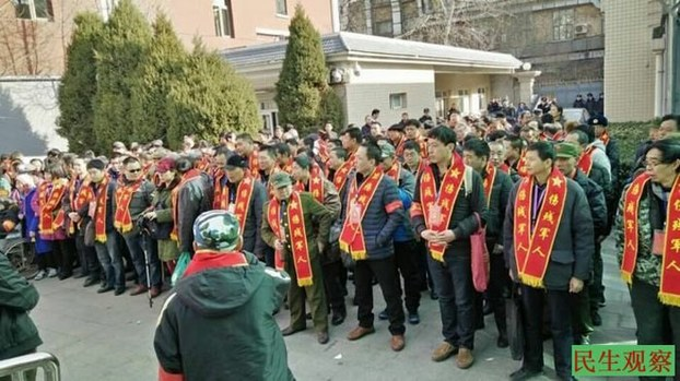 Some of the  thousands of disabled veterans during a protest at the Central Military Commission. The veterans traveled from the provinces to Beijing to petition the government to pay their pensions, Feb. 25, 2016.