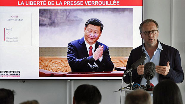 Christophe Deloire (R), general secretary of Reporters Without Borders, speaks at a press conference to present the watchdog's World Press Freedom Index for 2018, in Paris, April 25, 2018.