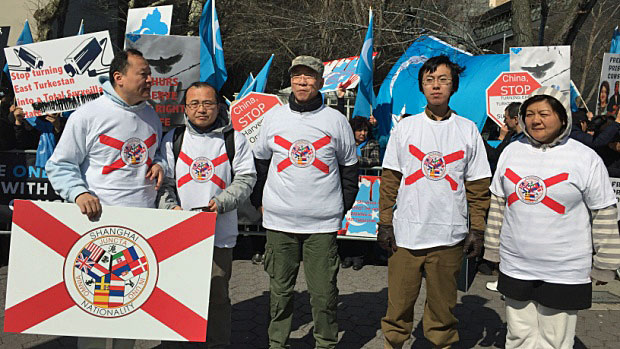 Members of the Shanghai National Party campaign for independence for Shanghai on a street in New York, May 5, 2018.