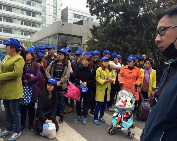 Parents of children affected by tainted vaccines gather in protest outside China's Health and Family Planning Commission in Beijing, April 2016.