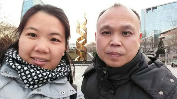 Chinese human rights lawyer Yu Wensheng (R) and his wife Xu Yan (L) are shown in an undated photo.