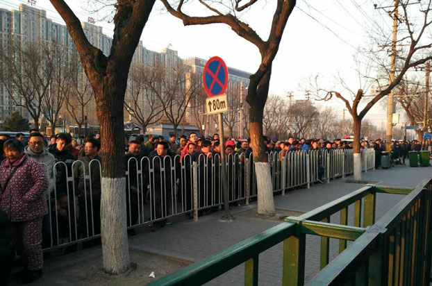 Crowds form outside the State Council complaints office in Beijing, March 1, 2017.