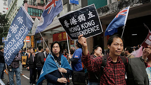 Hong Kong residents carry placards in a protest calling for the city's independence, Jan. 1, 2018.