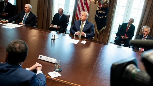 US President Donald Trump and Vice President Mike Pence meet with hotel and tourism executives in the Cabinet Room of the White House about the effect of the novel coronavirus, March 17, 2020.
