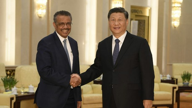 World Health Organization director general Tedros Adhanom (L) shakes hands with Chinese President Xi jinping before a meeting at the Great Hall of the People in Beijing, Jan. 28, 2020.