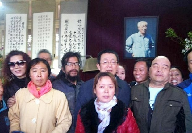 Petitioners visit the home of the late Zhao Ziyang during Qing Ming festival in Beijing, April 5, 2015.