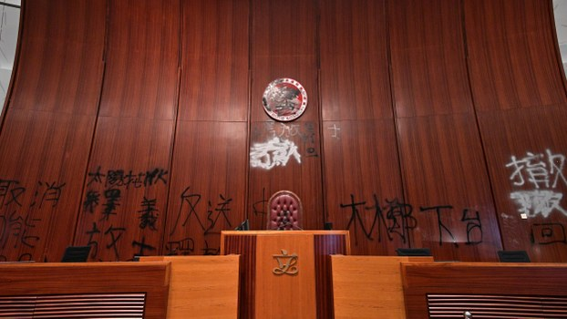 Graffiti is seen behind the speakers chair in the main chamber of the Legislative Council during a media tour in Hong Kong, July 3, 2019.