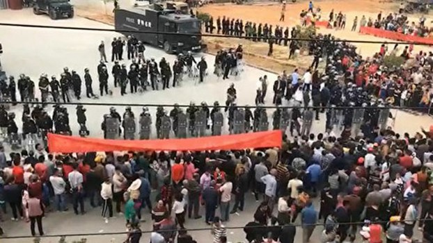 A showdown between protesters and riot police in the southern Chinese province of Guangdong over plans to build a public crematorium near Huazhou city, Nov. 28, 2019.