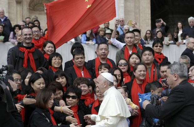 Pope Francis greets a group of Catholics from China in St. Peter's Square at the Vatican in a file photo.