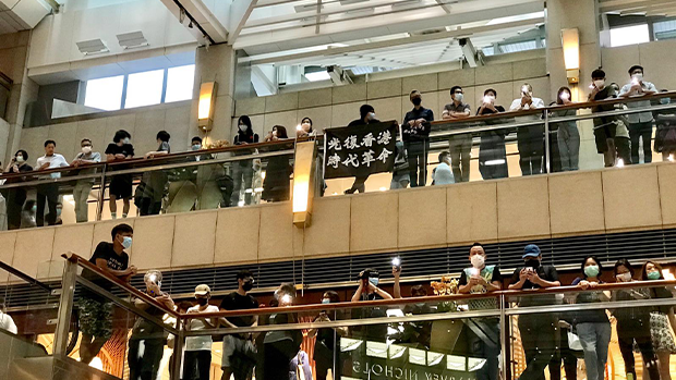 Protesters gather at Hong Kong's Landmark Mall to pledge continued resistance to China's national security law.