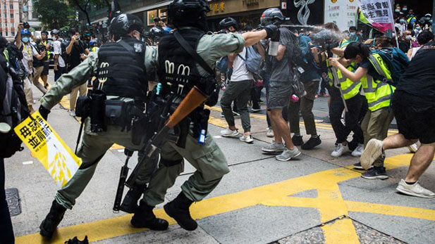 Hong Kong riot police use pepper spray to disperse protesters, July 1, 2020.