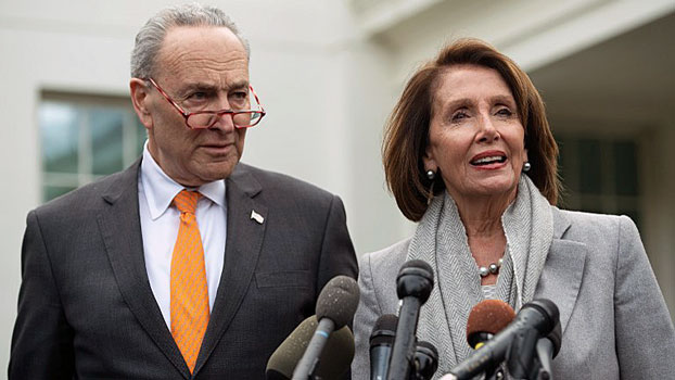 U.S. Speaker of the House Nancy Pelosi (R) and Senate Democratic Leader Chuck Schumer (L) speak to the media following a 