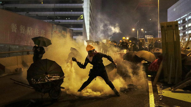 Protester throws tear gas canister back at police during a protest in Hong Kong, July 28, 2019.