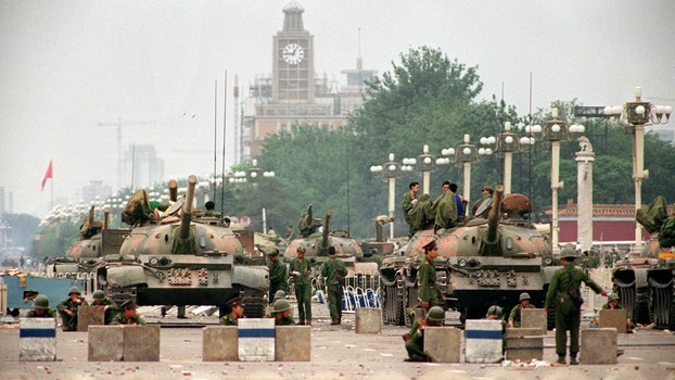 People's Liberation Army tanks and soldiers guard Chang'an Avenue leading to Tiananmen Square in Beijing two days after their crackdown on pro-democracy students, in a file photo.