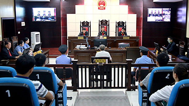 Ming Jingguo appears in court in Jiangxi province's Ganzhou city, Sept. 27, 2018.