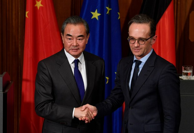 Chinese Foreign Minister Wang Yi (L) and German Foreign Minister Heiko Maas shake hands after a joint press conference after talks at the German Foreign Ministry's Villa Borsig in North Berlin, Feb. 13, 2020.
