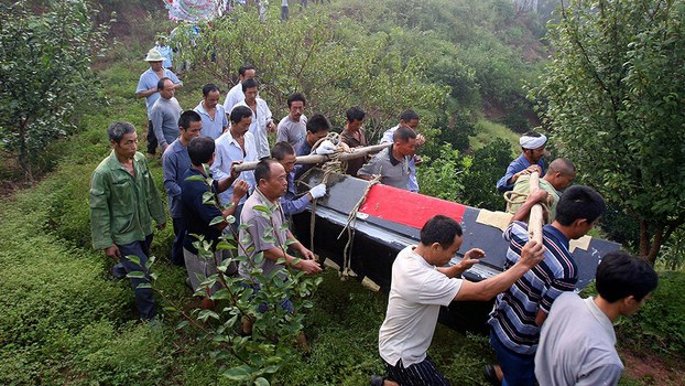Relatives take part in a funeral procession in Hunan province, in a file photo.