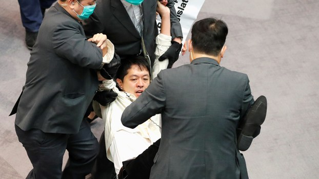 Pro-democracy lawmaker Xu Zhifeng is dragged out of Hong Kong's LegCo by security guards, May 18, 2020.