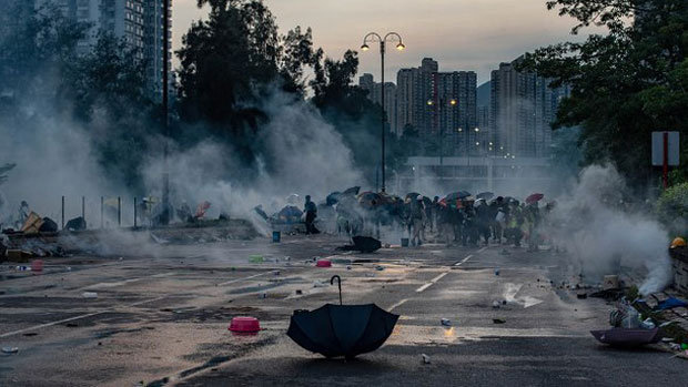 Protesters react after police fire tear gas in Hong Kong's Tai Po district during a general strike, Aug. 5, 2019.