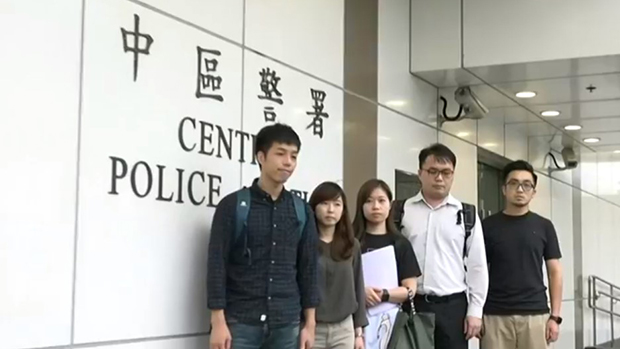 Michael Mo-chow Ngan (left) and a group of civil servants apply for a protest permit at Hong Kong's Central Police Station on July 29,2019.