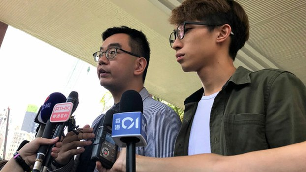 Hong Kong Civil Human Rights Front vice convenors Eric Lai (L) and Figo Chen (R) hold news conference on the previous day's bloody hammer attack on the group's convenor, Jimmy Sham, Oct 17, 2019.