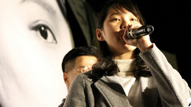 Agnes Chow, a Demosisto candidate who was barred from forthcoming elections to Hong Kong's  Legislative Council (LegCo), addresses a crowd on Jan. 28, 2018.