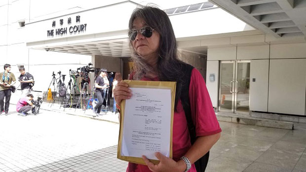 Ousted Hong Kong lawmaker and veteran rights activist Leung Kwok-hung lodges an application for a judicial review of legislation allowing mainland Chinese police to have jurisdiction at a high-speed rail checkpoint within the city, June 22, 2018.