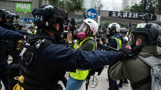 Police push a group of journalists after dispersing a crowd gathered for the 'universal siege on communists' rally at Chater Garden in Hong Kong, Jan. 19, 2020.