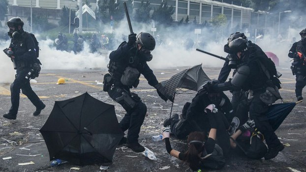 Police detain demonstrators in the Sha Tin district of Hong Kong, as violent demonstrations take place in the city on the National Day holiday to mark the 70th anniversary of communist China's founding, October 1, 2019.