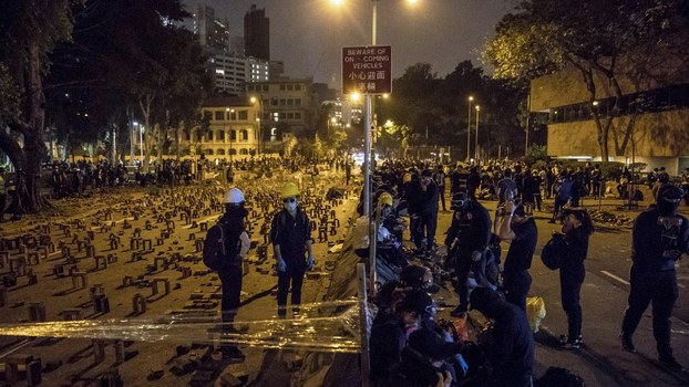 Protesters gather on a blocked road at the Hong Kong Polytechnic University, Nov. 14, 2019.