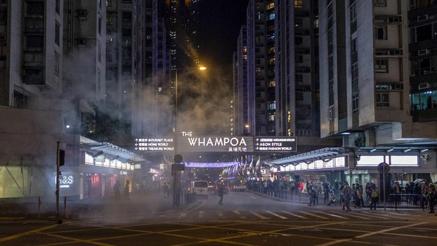Smoke of tear gas fired by police spreads during a protest at Hung Hom in Hong Kong, Dec. 1, 2019.
