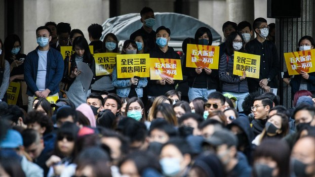 Workers from the advertising sector in Hong Kong attend a rally to commence a five day strike to demand the government to respond to the five demands of the city's pro-democracy protest movement, Dec. 2, 2019.