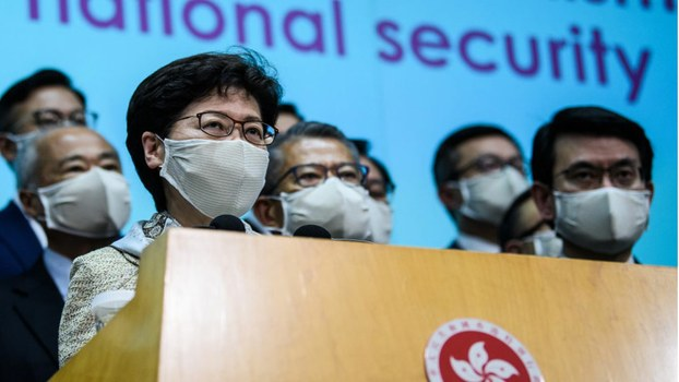 Hong Kong Chief Executive Carrie Lam (front L) holds a press conference in Hong Kong after attending the opening session of China's rubber-stamp National People's Congress in Beijing, May 22, 2020.