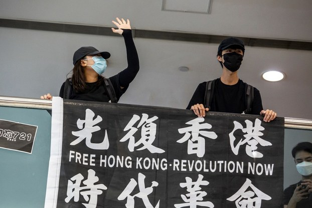 Pro-democracy demonstrators call for Hong Kong's independence protest, using a slogan banned under a new national security law imposed by China, in Tsim Sha Tsui waterfront in Hong Kong, May 10, 2020.