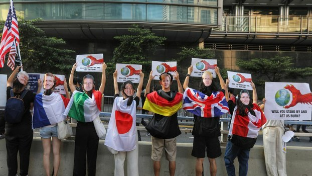 Protesters wear masks depicting various world leaders during a march to the U.S. consulate in Hong Kong to call on Congress to pass a recently proposed bill that expresses support for the protest movement, Sept. 8, 2019.