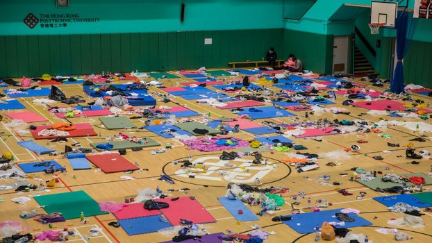 A dwindling core of protesters rest inside a sports hall after days of siege at Hong Kong Polytechnic University in Hong Kong, Nov. 21, 2019.