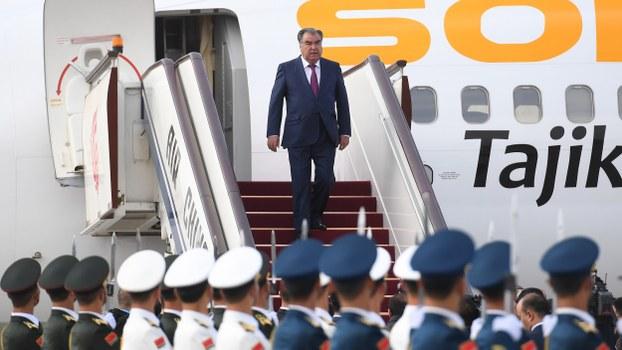 Tajikistan's President Emomali Rahmon (C) arrives at Beijing's airport ahead of the Belt and Road Forum, April 25, 2019.