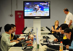 Journalists access the Internet at the international media center during the Beijing Olympics, Aug. 2008.