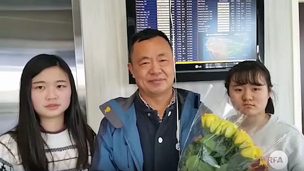 Chinese rights activist Zhang Lin (C) is greeted by his two daughters after arriving in the United States, Jan. 26, 2018.