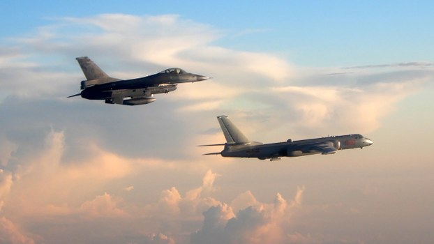 A Taiwanese F-16 fighter (L) jet monitors one of two Chinese H-6 bombers that flew over the Bashi Channel south of Taiwan, near Japan's Okinawa Island, May 25, 2018.