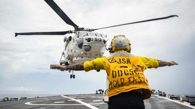 A Japanese Maritime Self Defense Force SH-60 helicopter from the Japanese helicopter destroyer JS Kaga (DDH-184) lands on the flight deck aboard the  USS John S. McCain (DDG 56) during flight operations in the South China Sea, Oct.12, 2020.