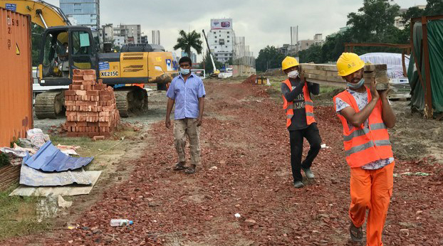 Bangladeshis work at the Chinese company Sinohydro's construction site in Dhaka, July 7, 2020.