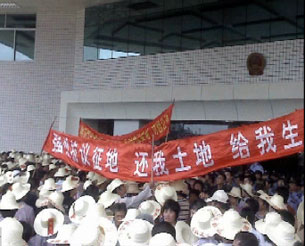 In an undated photo, residents of Guangdong province protest outside a government building in a land dispute.