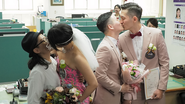 Two same-sex couples complete their marriage registrations in Taiwan, May 24, 2019.