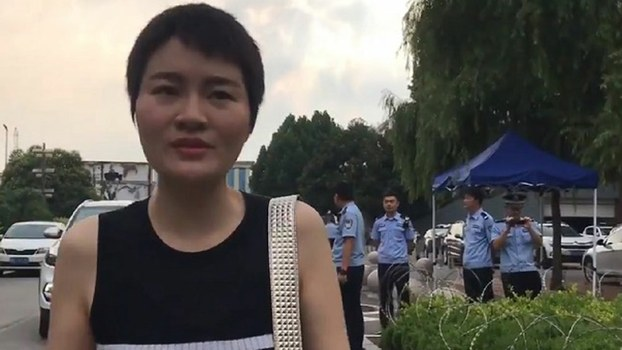 Li Wenzu, the wife of jailed Chinese rights attorney Wang Quanzhang, after she visited him for half an hour at Shandong's Linyi Prison and applied for his release on medical parole, July 30, 2019.