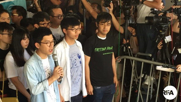 FromL-R: Nathan Law, Joshua Wong, and Alex Chow address the media before their sentencing in Hong Kong, Aug. 17, 2017.