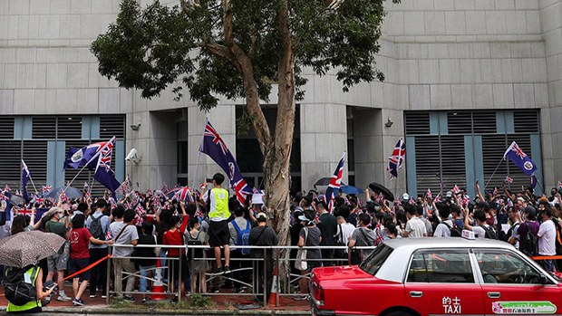 Hong Kong residents gather outside the British General Consulate in Hong Kong to call for the right of abode in the UK.